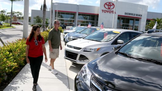 A salesperson (left) shows vehicles to a shopper at the Toyota of Deerfield dealership in Deerfield Beach, Florida.